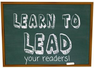 "chalk board with ""learn to lead your readers!"" on it"