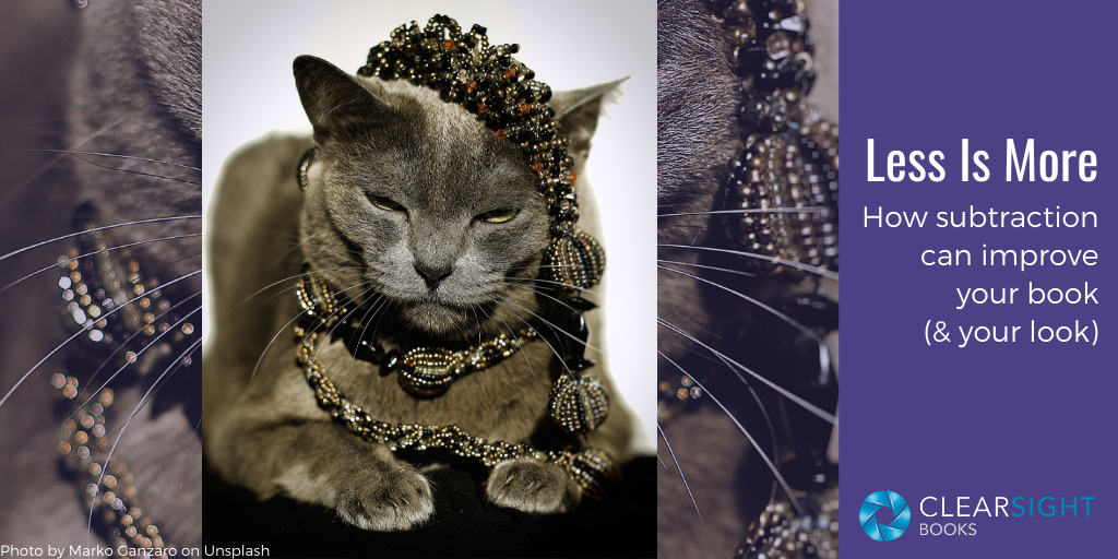 Image of cat wearing jewelry. Less is more: how subtraction can improve your book (and your look)